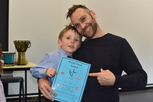 Dominic Byrne with Noah Byrne at Sacret heart getting the kindergarten blue award