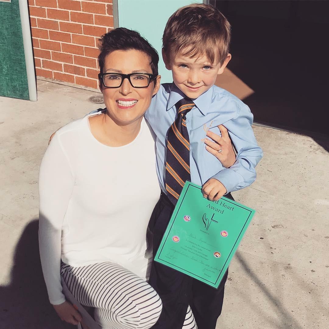 Louise DeCelis and Noah Byrne, Noah receiving the kindergarten blue award.