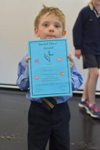 Noah Byrne getting the Kindergarten Blue award