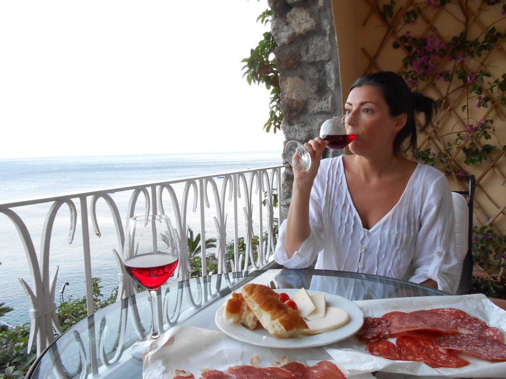 louise decelis drinking wine on Amalfi coast